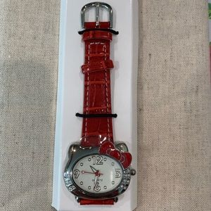 Avon watch with Hello Kitty style red band
